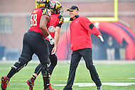College Park, MD - OCT 1, 2016: Maryland Terrapins head coach DJ Durkin is happy after a touchdown run by Maryland Terrapins running back Kenneth Goins Jr. (30) during game at Capital One Field at Maryland Stadium in College Park, MD. The Terps got the win 50-7 over visiting Purdue. (Photo by Phil Peters/Media Images International)