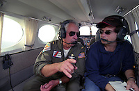Coast Guard Auxiliary Pilot RON DARCEY of Castro Valley  talks with Times reporter JOHN SIMMERMAN during a mission over the Northern California coast Wednesday Oct 13, 2004. The Livermore based crew with ramp up their flights over coastal waters as the November elections near.