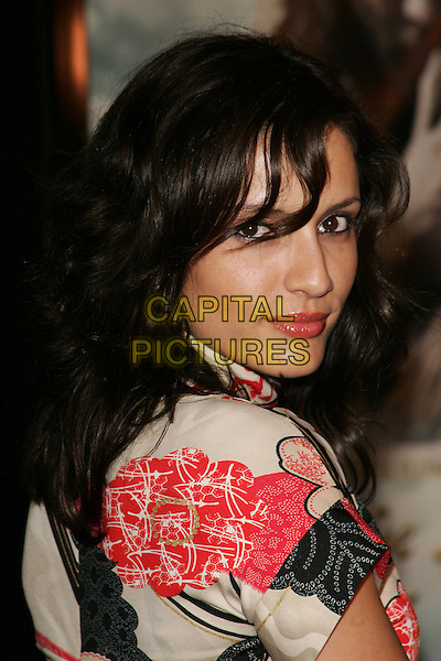 "LEONOR VARELA.""The New World"" Los Angeles Premiere to Benefit the American Film Institute held at the Academy of Motion Pictures Arts and Sciences, Beverly Hills, California. .December 15th, 2005.Photo: William Scott/AdMedia/Capital Pictures.Ref: WS/ADM.headshot portrait red black white looking over shoulder.www.capitalpictures.com.sales@capitalpictures.com.© Capital Pictures."