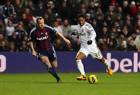 Saturday 19 January 2013<br /> Pictured L-R: Charlie Adam closely following Jonathan de Guzman of Swansea.<br /> Re: Barclay's Premier League, Swansea City FC v Stoke City at the Liberty Stadium, south Wales.