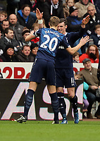 Pictured: Gareth Bale of Tottenham (R)  celebrating his goal with team captain Michael Dawson (L). Saturday 30 March 2013<br /> Re: Barclay's Premier League, Swansea City FC v Tottenham Hotspur at the Liberty Stadium, south Wales.