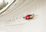 """5 December 2015: Katrin Heinzelmaier, competing for Austria, slides through Curve 10 """"Shady"""" on her first run of the Viessmann World Cup Women's Luge at the Olympic Sports Track in Lake Placid, New York, USA. Mandatory Credit: Ed Wolfstein Photo *** RAW (NEF) Image File Available ***"""