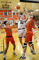 Westside Eagle Observer/MIKE ECKELS<br /> <br /> The battle of the 33's. Pioneer Garrison Jackson (33) tries to put up a jumper over the top of Lion Brayden Trembly (33) during the Garvette-Gentry varsity boys basketball contest in Gravette Jan. 7. The Lions defeated the Pioneers 53-32 for the first conference win of 2020.