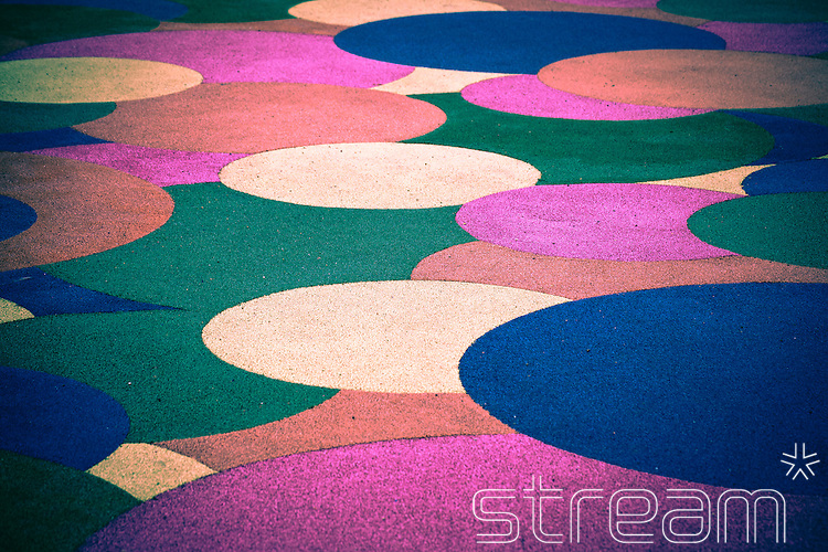 Multicoloured carpet with circle pattern.