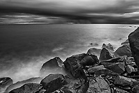 Waves crashing along the shoreline along the Gulf of St. Lawrence in storm light<br />