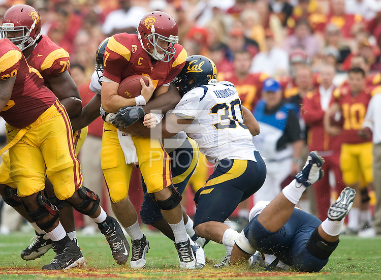 Mychal Kendricks of California sacks USC quarterback Matt Barkley during the game at LA Memorial Coliseum in Los Angeles, California.  USC defeated California, 48-14.