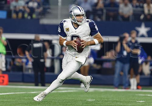 26.11.2015. Arlington, Texas, USA.  Dallas Cowboys Quarterback Tony Romo (9) during the NFL Thanksgiving game between the Carolina Panthers and the Dallas Cowboys played at AT&T Stadium in Arlington, TX.