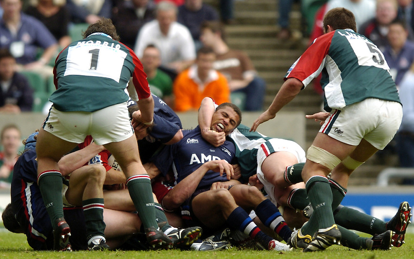 Photo: Richard Lane..Leicester Tigers v Sale Sharks. Zurich Wildcard Final at Twickenham. 29/05/2004..Jason Robinson gets his head ripped off.