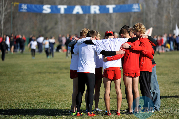 17 NOV 2012:  The team from Central College huddles together before the start of the race during the Division III Men's Cross Country Championship held at the LaVern Gibson Cross Country Course in Terre Haute, IN.  Alan Petersime/NCAA Photos