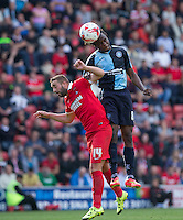 Marcus Bean of Wycombe Wanderers beats Sammy Moore of Leyton Orient to the ball during the Sky Bet League 2 match between Leyton Orient and Wycombe Wanderers at the Matchroom Stadium, London, England on 19 September 2015. Photo by Andy Rowland.