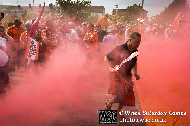 A smoke canister is ignited as home fans protest outside Bloomfield Road stadium before Blackpool hosted Portsmouth in an English League One fixture. The match was proceeded by a protest by around 500 home fans against the club's controversial owners Owen Oyston, many of whom did not attend the game. The match was won by the visitors by 2-1 with two goals by Ronan Curtis watched by just 4,154 almost half of which were Portsmouth supporters.
