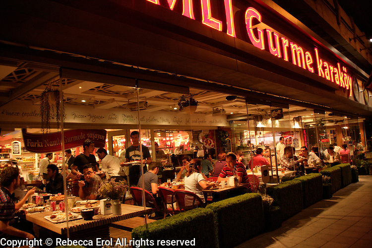 Turkish people eating out at the Namli Gurme at Karakoy, Istanbul, Turkey