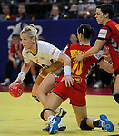 BELGRADE, SERBIA - DECEMBER 16: Heidi Loke (L) of Norway is challenged by Andjela Bulatovic of Montenegro (R) during the Women's European Handball Championship 2012 gold medal match between Norway and Montenegro at Arena Hall on December 16, 2012 in Belgrade, Serbia. (Photo by Srdjan Stevanovic/Getty Images)