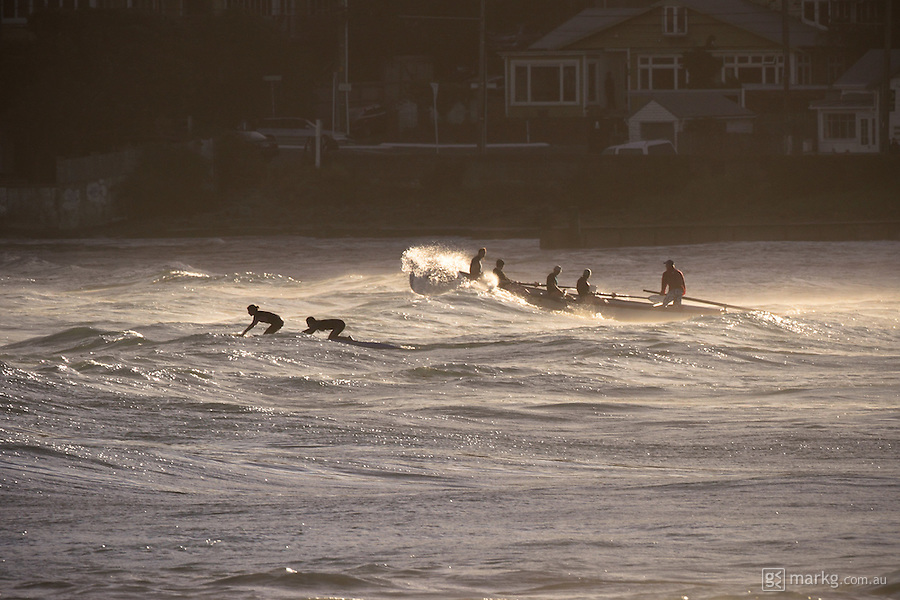 Lyall Bay SLSC board paddlers & boaties in a late afternoon training session at Lyall Bay