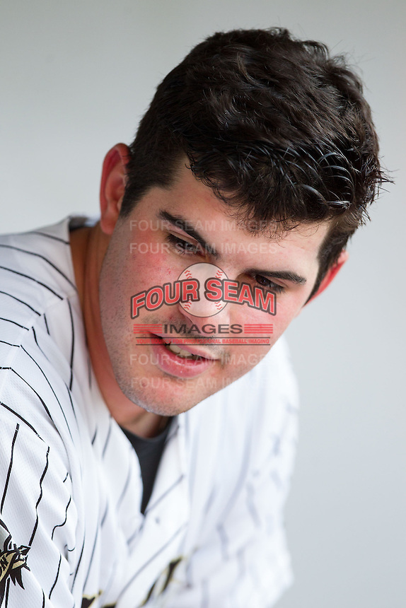 Charlotte Knights starting pitcher Carlos Rodon (41) sits in the dugout between innings of the game against the Gwinnett Braves at BB&T Ballpark on August 19, 2014 in Charlotte, North Carolina.  The Braves defeated the Knights 10-5.   (Brian Westerholt/Four Seam Images)