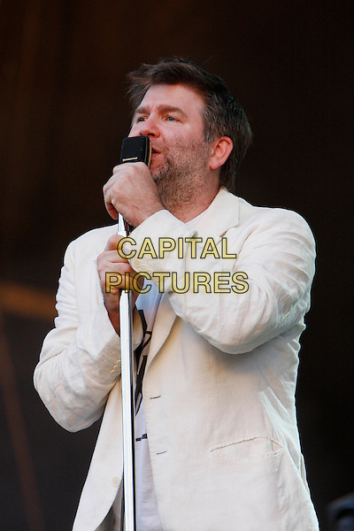LCD SOUNDSYSTEM  - James Murphy.Performing live at Wireless Festival 2010, Hyde Park, London, England, UK, July 3rd 2010..concert gig music on stage half length microphone singing cream white jacket blazer .CAP/MAR.© Martin Harris/Capital Pictures.