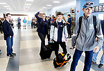 OXFORD CT. 11 March 2018-031219SV02-From left, Dorothy Potter, principal, Jack Fairhurst, 17, and Thomas Romeo, 17,leave for Abu Dhabi at Oxford High School in Oxford Tuesday. The two students are members of the schools Unified Sports team and will take part in a global youth summit at the Special Olympics. <br /> Steven Valenti Republican-American