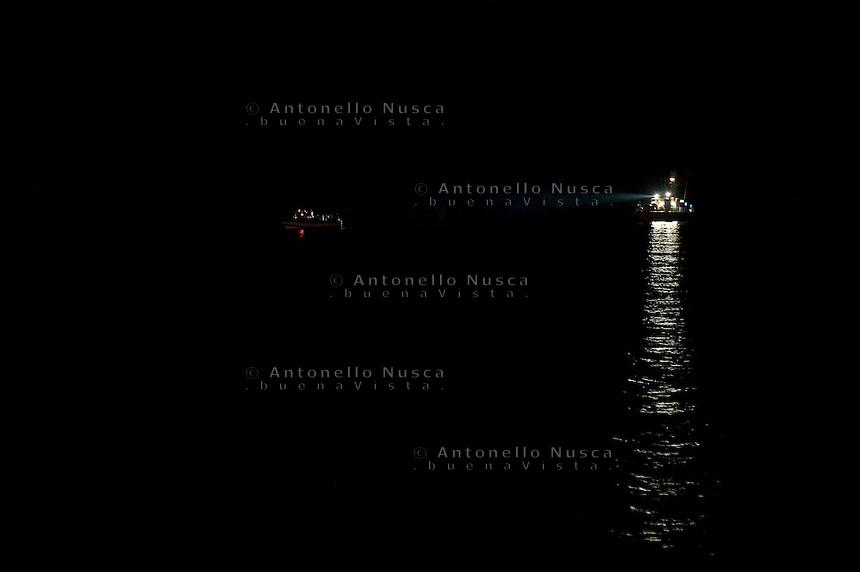 Una barca di clandestini Tunisini viene intercettata da una motovedetta della Capitaneria di Porto..A boat full of Tunisian immigrants during navigation to reach the Lampedusa island.
