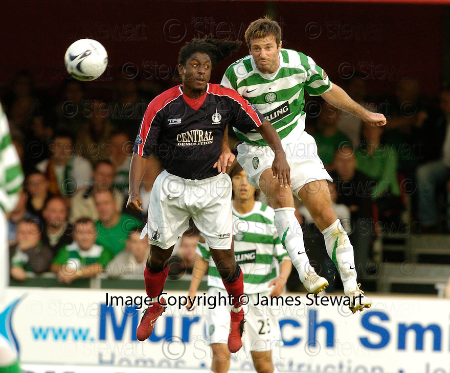 01/10/2006       Copyright Pic: James Stewart.File Name :sct_jspa07_falkirk_v_celtic.RUSSELL LATAPY AND MACIEJ ZURAWSKI CHALLENGE FOR THE BALL.....Payments to :.James Stewart Photo Agency 19 Carronlea Drive, Falkirk. FK2 8DN      Vat Reg No. 607 6932 25.Office     : +44 (0)1324 570906     .Mobile   : +44 (0)7721 416997.Fax         : +44 (0)1324 570906.E-mail  :  jim@jspa.co.uk.If you require further information then contact Jim Stewart on any of the numbers above.........