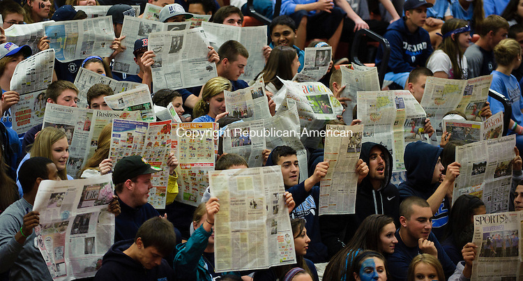 SHELTON, CT - 7 June 2013-060713EC01--    Students in the Oxford fan section pretend to read copies of the Republican-American while the members of Enfield boys volleyball team are introduced. The Wolverine's won the Class M state title, beating the Raiders 3-0 (25-23, 25-21, 25-20) Friday night in Shelton. Erin Covey Republican-American.