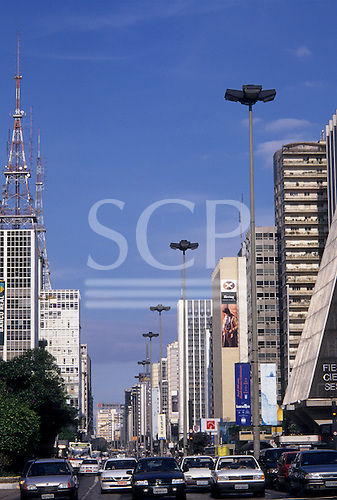 Sao Paulo, Brazil. Traffic on the Avenida Paulista in the business district with high rise office blocks.