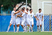 2 October 2011:  FIU's team (pictured from left to right, Quentin Albrecht (22, hugging De Sousa), Nicholas Chase (8), John Kite (15), Chris Lamarre (12), Lucas Di Croce (10), and Mario Uribe (17)), celebrates an overtime goal by Roberto De Sousa (20, center) as the FIU Golden Panthers defeated the University of Kentucky Wildcats, 1-0 in overtime, at University Park Stadium in Miami, Florida.