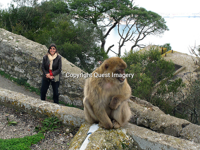 Posing with a monkey at the Rock of Gibraltar.<br />