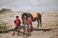 Two Sumbanese boys with a Pasola horse at the beach of Wainyapu. Pasola, the mock warfare between two villages, is held annually within the western region of the remote Indonesian island of Sumba. There will be blood, but in the hope for a good upcoming harvest, Sumbanese sees any bloodshed as a good sign.