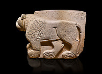 Hittite relief sculpted stone panel. Lion. Aslantepe Gate Limestone, Aslantepe, Malatya, 1200-700 B.C. Anatolian Civilisations Museum, Ankara, Turkey.<br /> <br /> The lion on the left of the two lions at the gate of the palace. His head and his front part were processed as high embossing and his body as regular embossing. The signs behind the lion and over his tail read; &quot;Halposulupis, Mighty (?) King&quot;.<br /> <br /> Against a black background.
