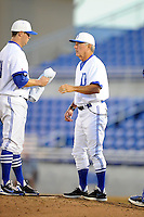Dunedin Blue Jays pitching coach Darold Knowles (32) talks with pitcher Scott Copeland (left) during a game against the Fort Myers Miracle on July 20, 2013 at Florida Auto Exchange Stadium in Dunedin, Florida.  Fort Myers defeated Dunedin 3-1.  (Mike Janes/Four Seam Images)