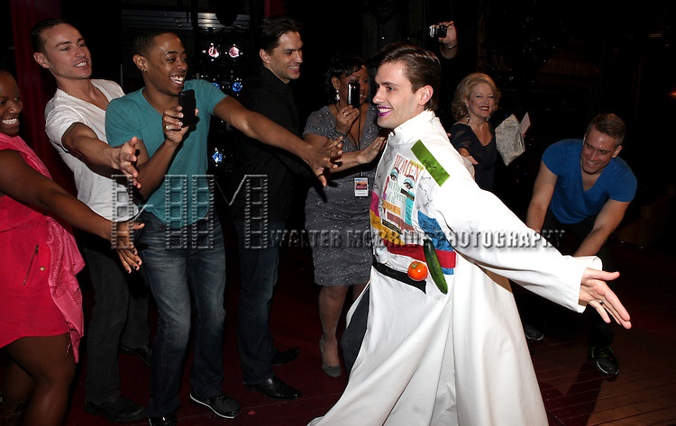 Eric Sciotto (Gypsy Robe Recipient for PRISCILLA)  with the ensemble cast.attending the Broadway Opening Night Gypsy Robe Ceremony for 'Priscilla Queen of the Desert - The Musical' at the Palace Theatre in New York City.