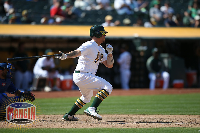 OAKLAND, CA - AUGUST 16:  Bruce Maxwell #13 of the Oakland Athletics bats against the Kansas City Royals during the game at the Oakland Coliseum on Wednesday, August 16, 2017 in Oakland, California. (Photo by Brad Mangin)