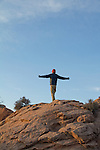 Canyonlands National Park, Utah, Backpacking, Scott McCredie, man stretching, Southwest, United States, USA,