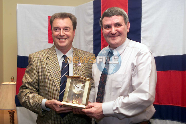 Capt. Neil Myles (Hon. Sec.) presenting Paddy Levins with a clock from the local branch of the R.N.L.I. to mark his retirement..Picture: Paul Mohan/Newsfile