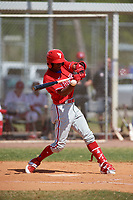Philadelphia Phillies Johan Rojas (33) hits a single during an exhibition game against the Canada Junior National Team on March 11, 2020 at Baseball City in St. Petersburg, Florida.  (Mike Janes/Four Seam Images)