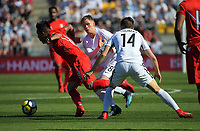 Peru's Wilder Cartagena tries to get past Michael McGlinchey and Ryan Thomas (14) during the 2018 FIFA World Cup Russia first-leg playoff football match between the NZ All Whites and Peru at Westpac Stadium in Wellington, New Zealand on Saturday, 11 November 2017. Photo: Dave Lintott / lintottphoto.co.nz