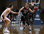 SIOUX FALLS, SD: MARCH 20:  Ryan Krawczeniuk #14 of East Stroudsburg looks past Northern State defender Bo Fries #15 during their game at the 2018 Division II Men's Elite 8 Basketball Championship at the Sanford Pentagon in Sioux Falls, S.D. (Photo by Dick Carlson/Inertia)