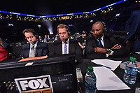 """BROOKLYN, NY - DECEMBER 22: (L-R ) Sports commentators Kenny Albert Joe Goossen and Lennox Lewis sit ring side before the start of the Fox Sports and Premier Boxing Champions  December 22 """"PBC on Fox"""" Fight Night at the Barclays Center on December 22, 2018 in Brooklyn, New York. (Photo by Anthony Behar/Fox Sports/PictureGroup)"""
