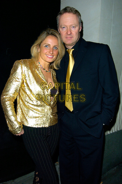 TESSA BREMNER & RORY BREMNER.The Harper's Bazaar & Moet Gold party, Almada bar & nightclub, London, England..November 1st, 2007.half 3/4 length black coat jacket suit pinstripe trousers cut out away married husband wife .CAP/CAN.©Can Nguyen/Capital Pictures