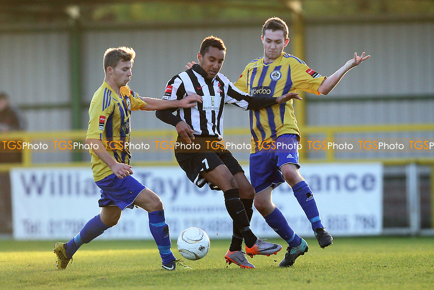Nicky Howell of Dereham shields the ball from Joe Oates (R) and Robbie Norris - Romford vs Dereham Town - Ryman League Division One North Football at Ship Lane, Thurrock FC - 02/11/13 - MANDATORY CREDIT: Gavin Ellis/TGSPHOTO - Self billing applies where appropriate - 0845 094 6026 - contact@tgsphoto.co.uk - NO UNPAID USE