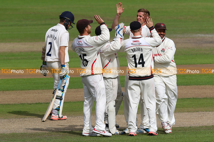 Toby Lester (2nd R) of Lancashire is congratulated by his team mates after taking the wicket of Liam Dawson (L) - Lancashire CCC vs Essex CCC - LV County Championship Division Two Cricket at Emirates Old Trafford, Manchester - 08/07/15 - MANDATORY CREDIT: Gavin Ellis/TGSPHOTO