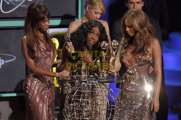 MICHELLE WILLIAMS, KELLY ROWLAND & BEYONCE KNOWLES (DESTINY'S CHILD).Receive award at The World Music Awards-Show held at the Kodak Theatre,.Hollywood, 31st  August 2005.half length stage gig concert silver sequin sparkly dress pink leopard print gold trophy.www.capitalpictures.com.sales@capitalpictures.com.© Capital Pictures.