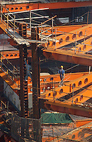 Workers assemble iron girders on the 66th and 67th floors of the Mori Tower, now under construction in Shanghai. The 101-floor building will be the tallest in the world on completion in 2008.