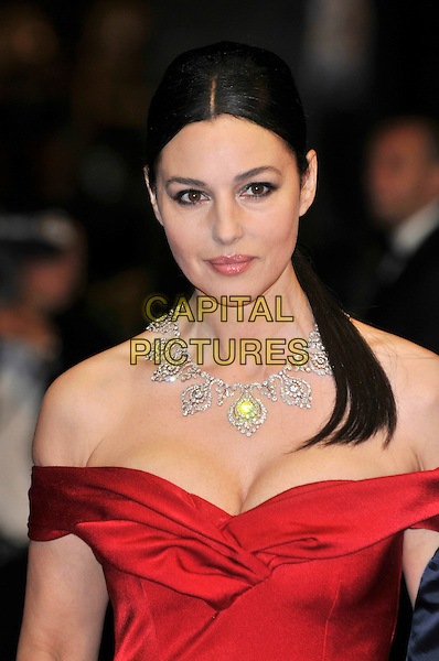MONICA BELLUCCI.'Ne Te Retourne Pas' (Don't Look Back) screening at 62nd International Cannes Film Festival.Cannes, France. 16th May 2009.portrait headshot ponytail red strapless off the shoulder shoulders dress necklace diamonds cleavage .CAP/PL.©Phil Loftus/Capital Pictures