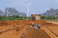 India Muppandal, large wind farm with Vestas wind turbines and women work at brick industry unit at Cape Comorin