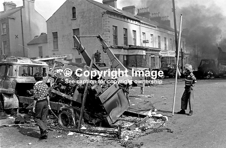 The fifth anniversary of the introduction of internment on 9th August 1971 was marked with disturbances and the hijacking and burning of vehicles. This picture was taken on the Falls Road, Belfast, N Ireland. 197608090356b..Copyright Image from Victor Patterson, 54 Dorchester Park, Belfast, United Kingdom, UK...For my Terms and Conditions of Use go to http://www.victorpatterson.com/Victor_Patterson/Terms_%26_Conditions.html
