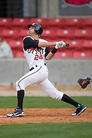 Eric Eymann #24 of the Carolina Mudcats follows through on his swing versus the Jacksonville Suns at Five County Stadium May 18, 2009 in Zebulon, North Carolina. (Photo by Brian Westerholt / Four Seam Images)