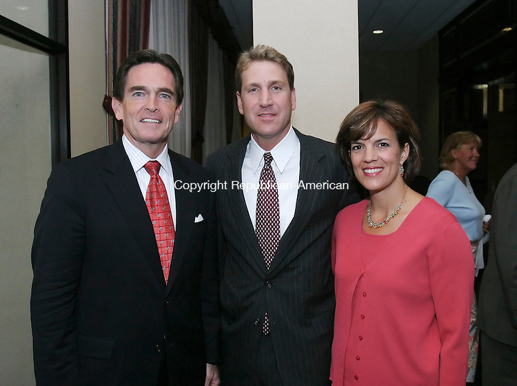 WATERBURY,  CT 12 September 2005 -091205BZ14-  From left-  Sponsors James Smith, Chairman and C.E.O. of Webster Bank; Bob Anthony, attorney at Brown Rudnick, LLP; and Peg Anthony, of Cheshire;<br /> <br /> during the Saint Mary's Hospital 10th Annual Champion Golf Classic &quot;Dinner of Champions&quot; Monday night.<br />  Jamison C. Bazinet / Republican-American
