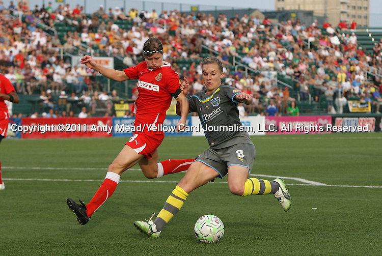 27 August 2011: Philadelphia's Amy Rodriguez (8) and Western New York's Rebecca Moros (behind). Western New York Flash defeated the Philadelphia Independence 5-4 on penalty kicks to win the final after the game ended in a 1-1 tie after overtime at Sahlen's Stadium in Rochester, New York in the Women's Professional Soccer championship game.