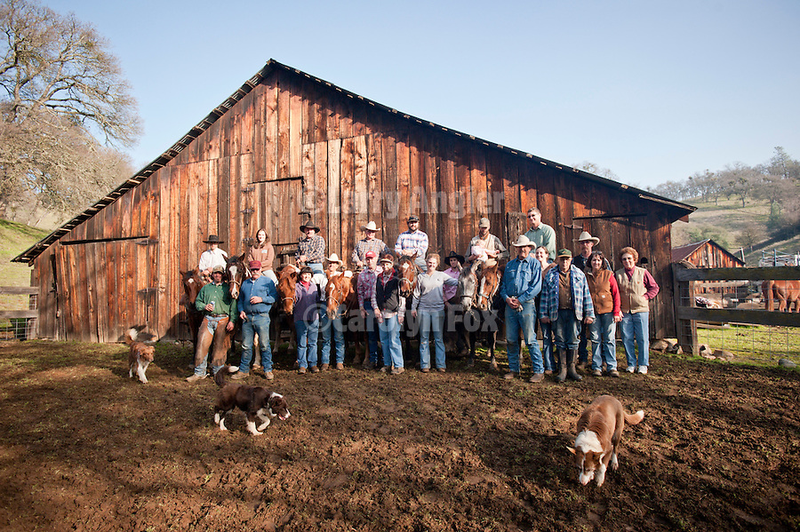 Crew portrait at the barn after wInter calf marking and branding with the Dell'Orto outfit at the Ellis Ranch, Amador County, Calif.